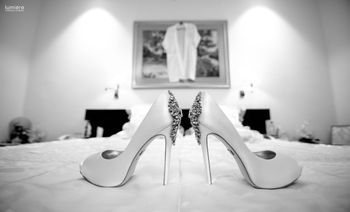 Studded white bridal heels