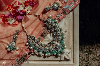 Gorgeous kundan jewellery with green beads and pearls