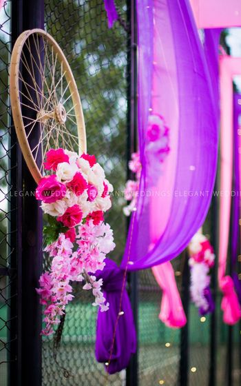 Photo of Cycle wheel prop with flowers and pink and purple theme