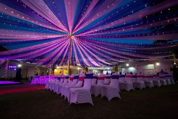 Photo of Night wedding decor idea with purple and blue tent