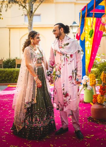 funky floral mehendi outfits for the bride and groom
