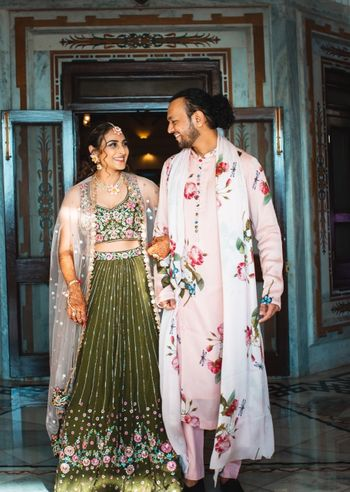 cute bride and groom mehendi outfits with florals