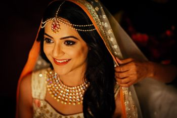 Photo of Bride in minimal jewellery and diamond necklace