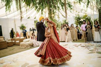 sikh bride twirling in red and gold lehenga