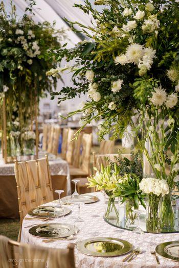Photo of floral table centrepieces white theme decor