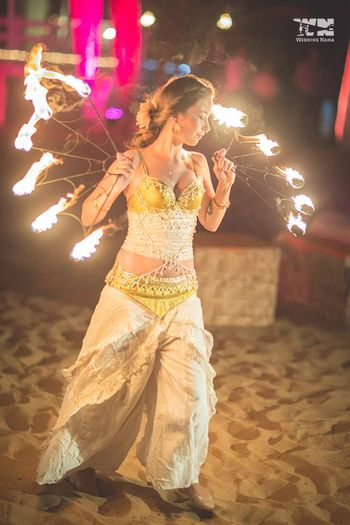 Fire dancer at sangeet for guests