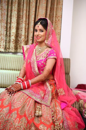 Photo of orange and pink bridal lehenga