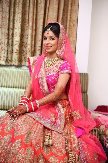 orange and pink bridal lehenga