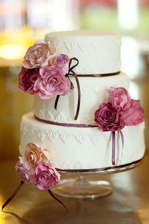 Photo of elegant white and purple cake