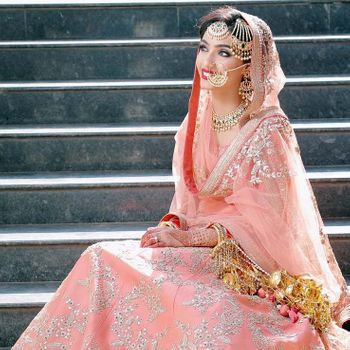Pakistani bridal look with jewellery and dupatta draping style
