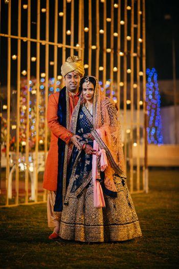 Royal blue and gold embellished bridal lehenga