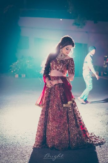 Maroon and gold floral embroidery lehenga for reception