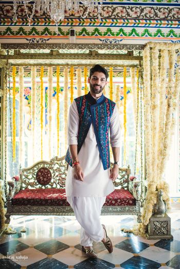 Mehendi groom wear kurta with blue jaipuri jacket