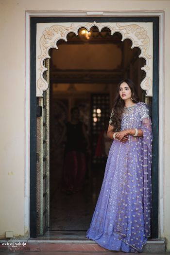 Photo of Lavender net lehenga with silver motifs