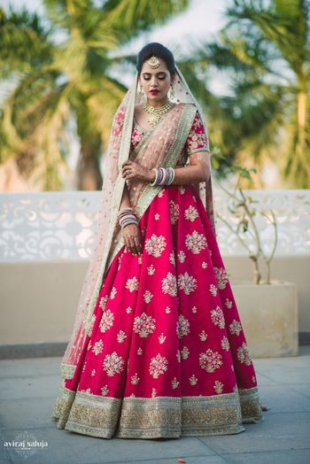 Photo of Red and light pink bridal lehenga