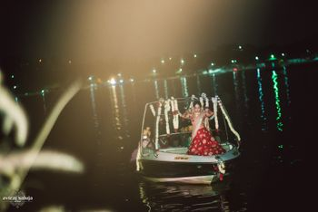 Photo of Unique bridal entry with bride entering on a boat