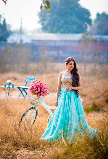 Photo of Turquoise cut out gown for engagement