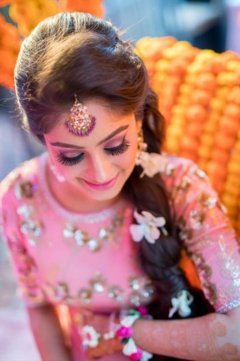Mehendi look with pink makeup and side braid