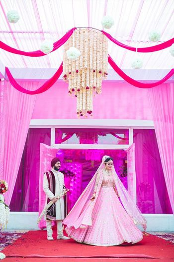 Morning wedding sikh bride in light pink lehenga and pink decor