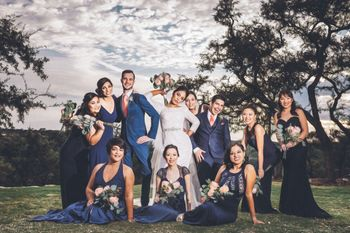 Couple with matching bridesmaids in blue