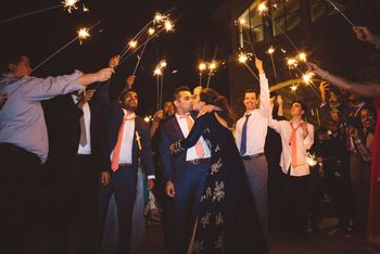 Photo of Couple entry idea with guests holding sparklers