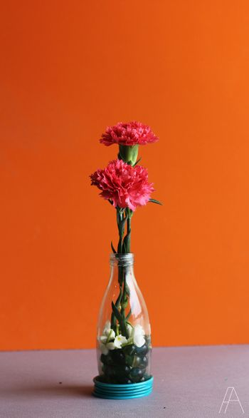 Photo of Table setting with glass bottle and flowers