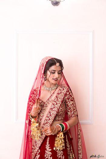 Bridal portrait in maroon bridal lehenga