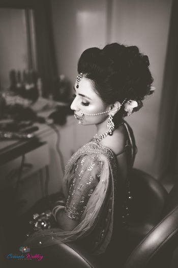 Black and white photography bridal portrait while getting ready
