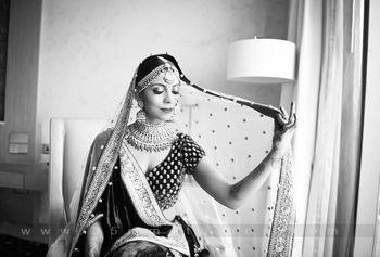 Bride holding dupatta bridal portrait idea in black and white