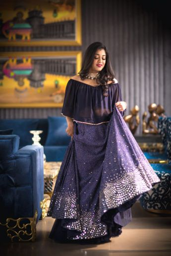 Purple lehengas with silver motifs and off shoulder blouse