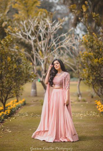Light peach engagement lehengas with cape sleeves