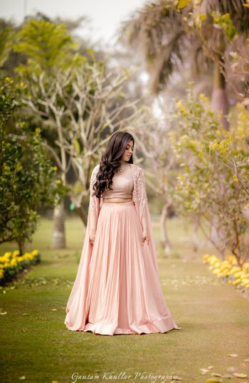 Light peach lehengas with cape sleeves for engagement