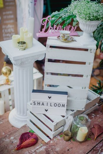 All white decor idea to display personalised wedding hashtag