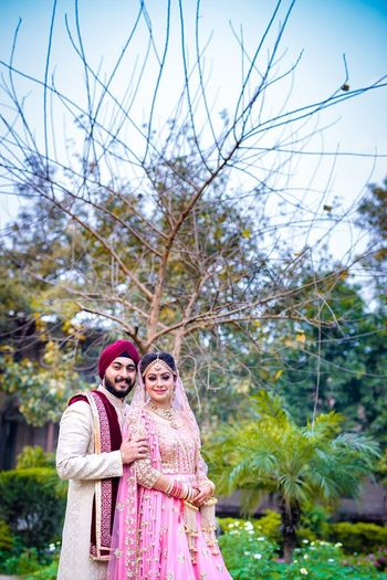 Mismatched Sikh couple portrait in morning wedding