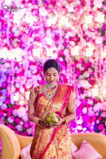 South Indian bride in red and gold kanjivaram