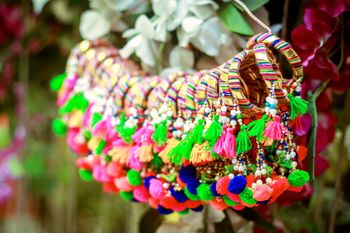 Hanging gota bangles with tassels and pompoms as mehendi favours