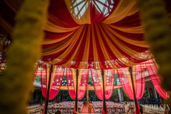 Photo of South Indian Wedding Pink and Yellow Canopy tents decor