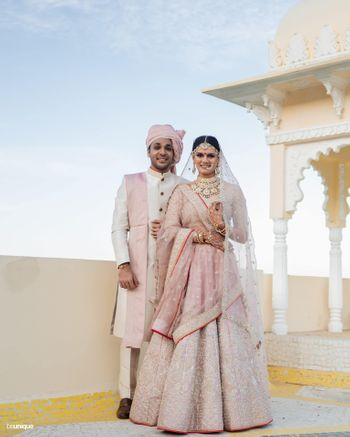 Photo of A lovely couple colour-coordinating in pink.