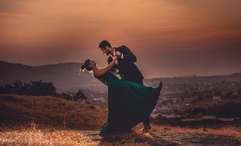 Romantic couple dancing pre-wedding shot in moutains