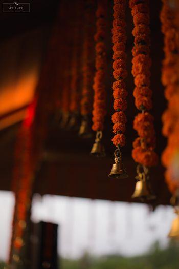 Hanging temple bells South Indian mandap decor