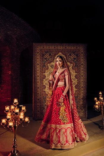 Bride wearing a red lehenga on her wedding day.