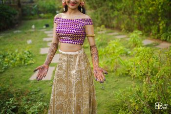 Photo of Off shoulder crop top and golden benarasi skirt