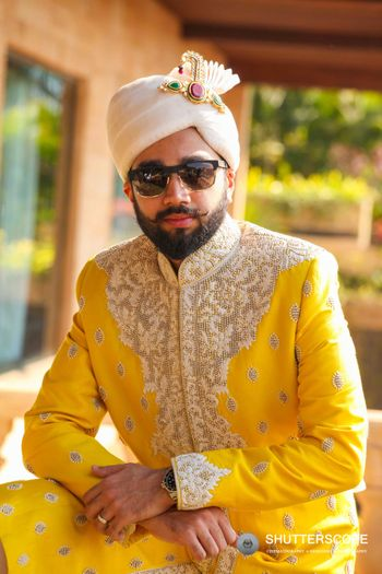 Groom in yellow sherwani for summer wedding