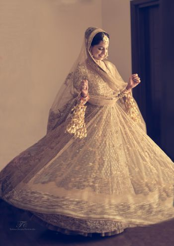 Photo of gold bridal portrait