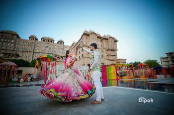 Twirling bride shot in bright shaded lehenga
