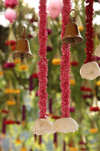 Hanging temple bells and floral strings South Indian wedding decor