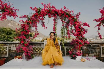 Beautiful bridal portrait on haldi with a pretty backdrop