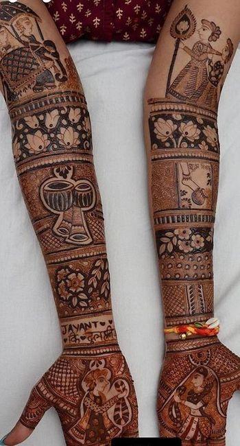 Intricate full hand mehendi design