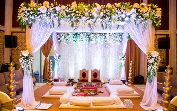 Fairytale mandap with drapes and dreamy lighting