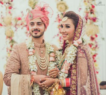 Photo of pink and gold sherwani